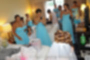 Jean Andrade comes out to show her bridal party her wedding dress.