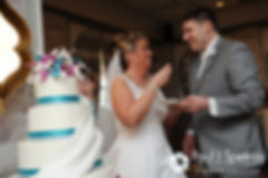 Angela and Shawn cut the cake at their spring 2016 Rhode Island wedding at the Hotel Viking in Newport, Rhode Island.