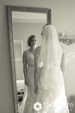 Rachel looks in the mirror prior to her October 2017 wedding ceremony at Castle Manor Inn in Gloucester, Massachusetts.