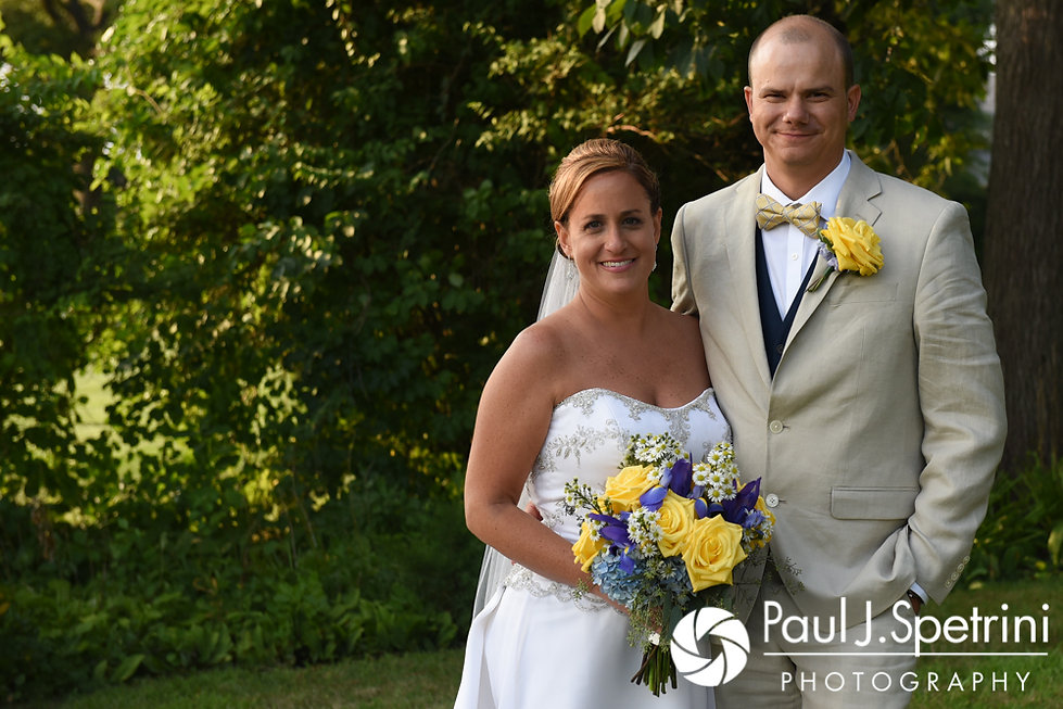 Rebecca and Kelly pose for a formal photo prior to their August 2017 wedding reception in Warwick, Rhode Island.