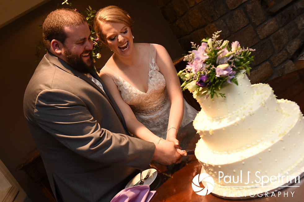 Melissa and Jordan cut their wedding cake during their May 2017 wedding reception at Independence Harbor in Assonet, Massachusetts.
