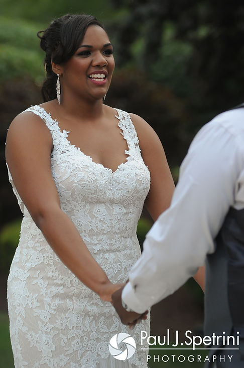 Kemi looks at Warren during her August 2016 wedding reception at the Villa at Riddler Country Club in East Bridgewater, Massachusetts.