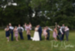 Ashley and Adam pose for a photo with their wedding party following their September 2018 wedding ceremony at Stepping Stone Ranch in West Greenwich, Rhode Island.