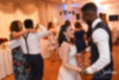 Courtnie and Richardson dance with guests during their August 2018 wedding reception at Emerald Hall in Abington, Massachusetts.