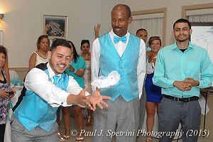 Jean Andrade's son catches the garter.