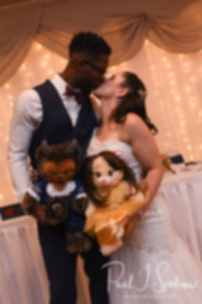 Courtnie and Richardson kiss during their August 2018 wedding reception at Emerald Hall in Abington, Massachusetts.