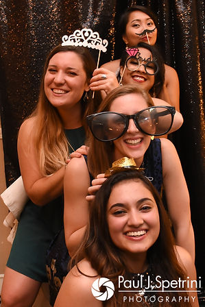 Stephany poses for a photo with guests during her September 2017 wedding reception at Wannamoisett Country Club in Rumford, Rhode Island.