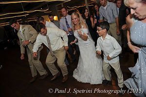 Jamie Bolani dances with a guest during her June 2015 wedding reception.