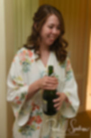Sarah pops a bottle of champagne prior to her June 2018 wedding ceremony at the College of the Holy Cross in Worcester, Massachusetts.
