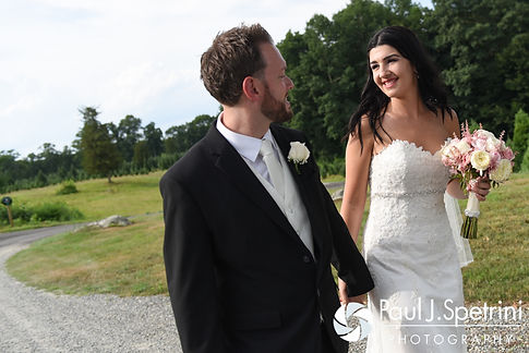 Lauryn and Justin take a walk during their July 2016 wedding reception at the Overlook at Geer Tree Farm in Griswold, Connecticut.
