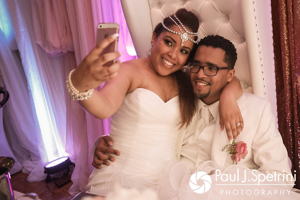 Lucelene and Luis pose for a photo during their June 2017 wedding reception at Al's Waterfront Restaurant in East Providence, Rhode Island.