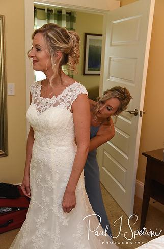 Nicole has her dress zipped prior to her November 2018 wedding ceremony at the Publick House Historic Inn in Sturbridge, Massachusetts.
