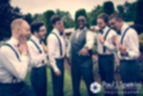 Warren and his groomsmen pose for a formal photo prior to his August 2016 wedding reception at the Villa at Riddler Country Club in East Bridgewater, Massachusetts.