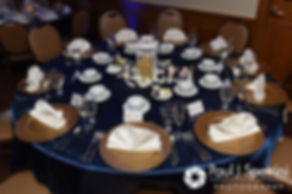 A look at the table settings during Jennifer and Mark's September 2016 wedding reception at the RI Shriners and Imperial Room at Rhodes Place in Providence, Rhode Island.