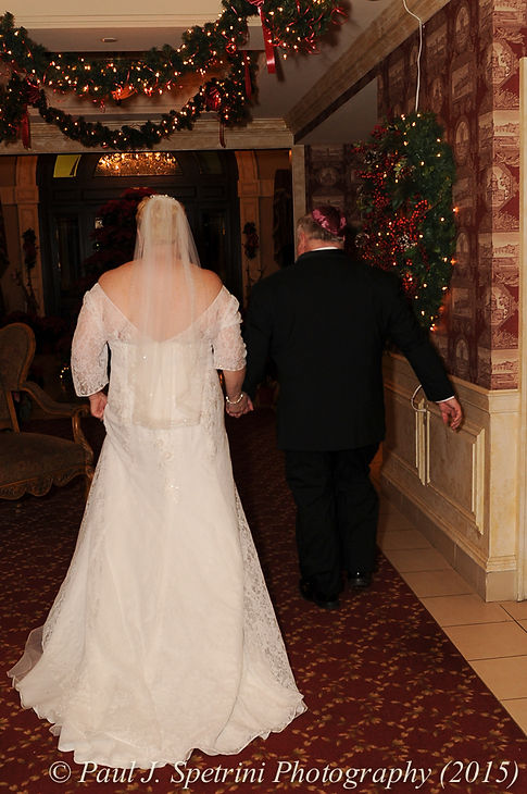 Ron and Cathy walk together during their December 2015 Rhode Island wedding at Quidnessett Country Club in North Kingstown, RI.
