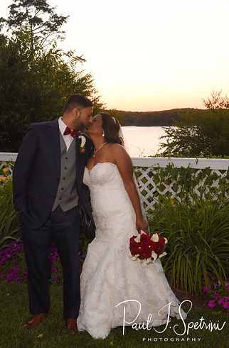 Jimmy & Saken pose for a formal photo at sunset during their July 2018 wedding reception at Lake Pearl in Wrentham, Massachusetts.