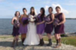 Beth poses for a formal photo with her bridesmaids following her August 2018 wedding ceremony at Fort Phoenix in Fairhaven, Massachusetts.