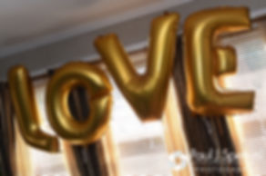 A sign hangs in Jennifer's parents home prior to her September 2016 wedding at the Roger Williams Park Temple of Music in Providence, Rhode Island.