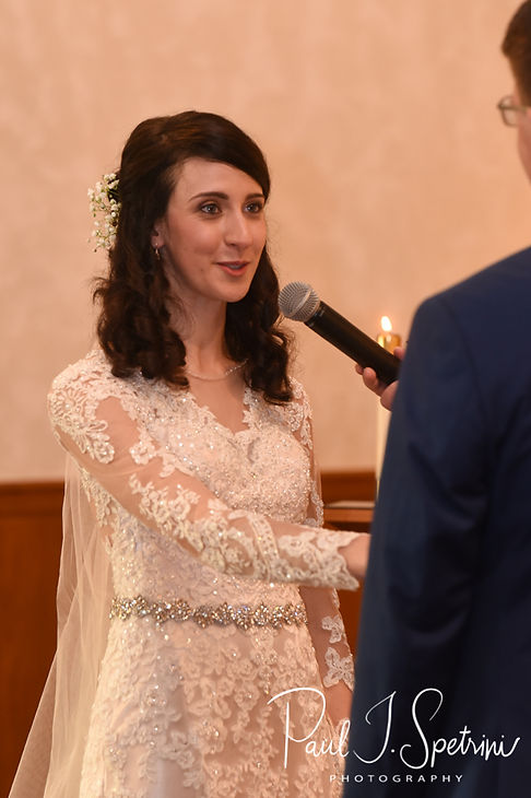 Stacey looks at Mack during her December 2018 wedding ceremony at St. Teresa's Church in Attleboro, Massachusetts.