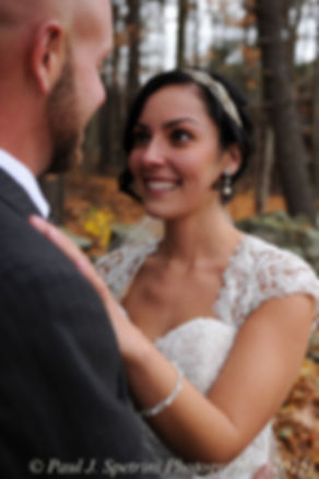 Emma smiles while looking at Mike prior to their November 2015 wedding at the Publick House in Sturbridge, Massachusetts.