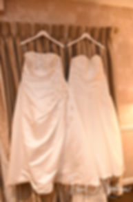 A look at Laura and Marijke's bridal gowns, taken in a photo during during their June 2018 wedding reception at Independence Harbor in Assonet, Massachusetts.