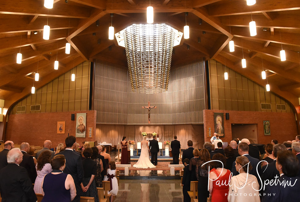 Meghan and Brian hold hands during their September2018 wedding ceremony at Immaculate Conception Church in Cranston, Rhode Island.