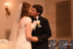 Brian and Sarah kiss during their June 2018 wedding ceremony at the College of the Holy Cross in Worcester, Massachusetts.