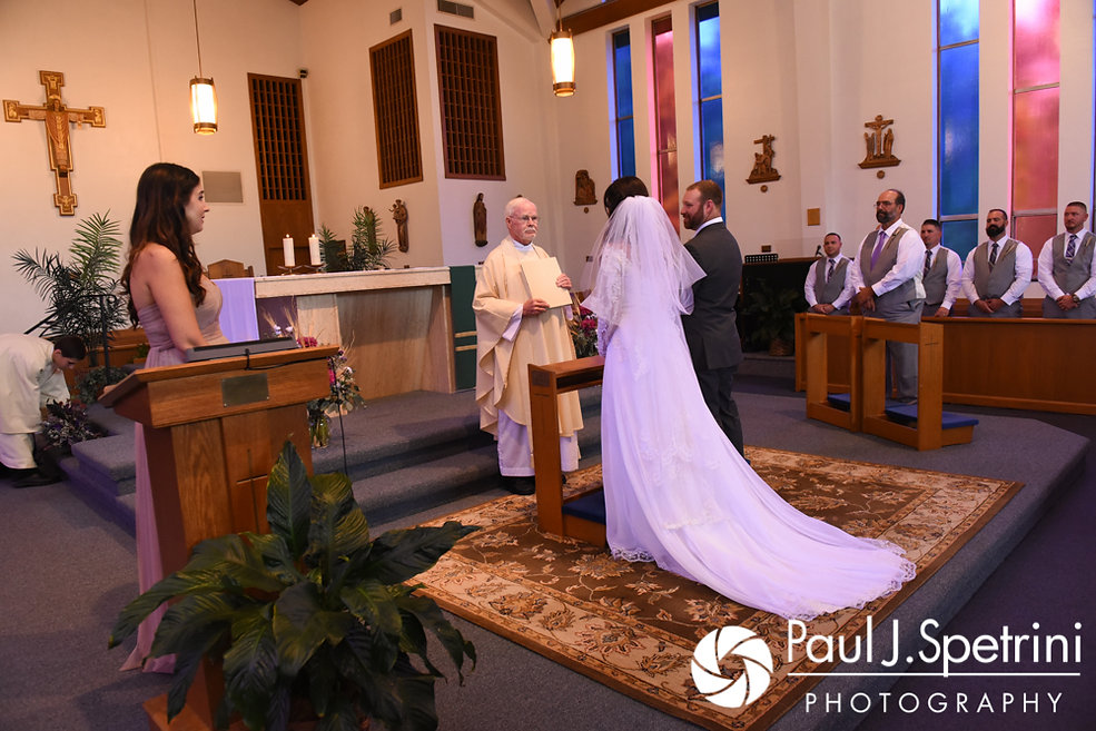 Samantha and Dale stand together during their October 2017 wedding ceremony at St. Robert's Church in Johnston, Rhode Island.