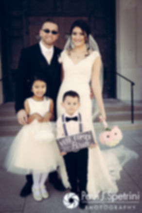 Maria and Sebastian pose for a photo with their ring bearer and flower girl following their March 2016 Rhode Island wedding at the Church of St. John the Baptist in Pawtucket, Rhode Island.