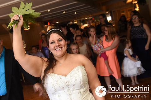 Clarissa tosses her bouquet during her June 2017 wedding reception at Twelve Acres in Smithfield, Rhode Island.