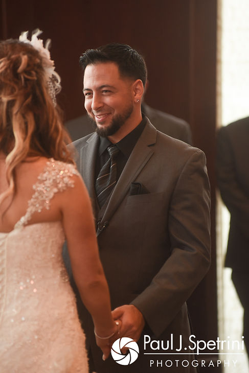 Dallas looks at Nicky during his September 2017 wedding ceremony at the Crowne Plaza Hotel in Warwick, Rhode Island.