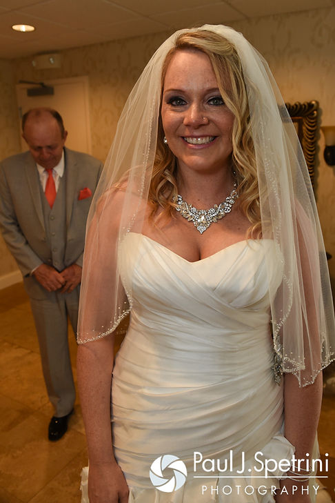 Michelle waits for her father to see her in her wedding dress for the first time prior to her May 2016 wedding at Hillside Country Club in Rehoboth, Massachusetts.