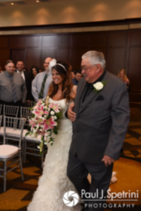 Nicky and her father walk down the aisle during her September 2017 wedding ceremony at the Crowne Plaza Hotel in Warwick, Rhode Island.