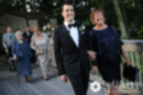 Laki walks down the aisle with his mother during his September 2017 wedding ceremony at Lake of Isles Golf Club in North Stonington, Connecticut.
