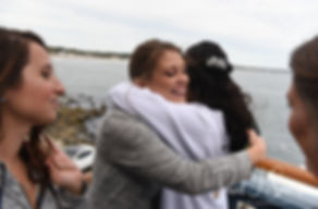 Nicole receives a hug prior to her September 2018 wedding ceremony at The Towers in Narragansett, Rhode Island.