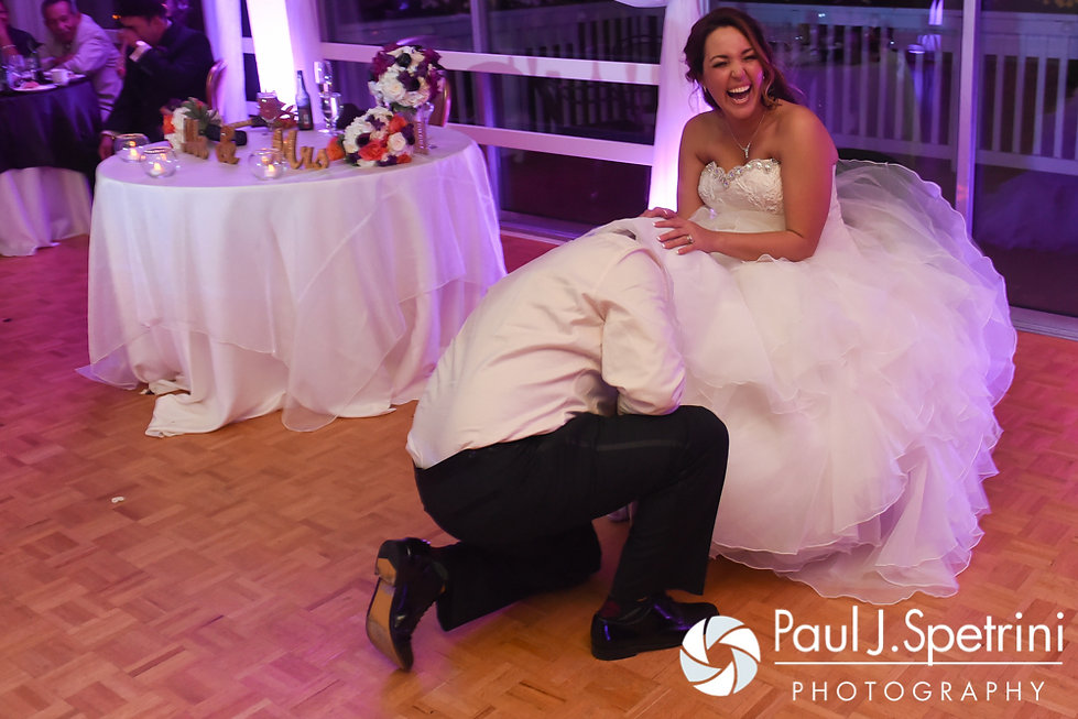 Stephanie laughs as Henry reaches for the garter during her October 2016 wedding reception at Lake Pearl Luciano's in Wrentham, Massachusetts.