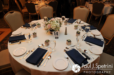 A look at the table settings during Nathan and Amy's November 2017 wedding reception at Quidnessett Country Club in North Kingstown, Rhode Island.