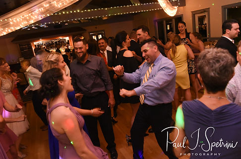Guests dance during Kendra & Joe's May 2018 wedding reception at Crystal Lake Golf Club in Mapleville, Rhode Island.