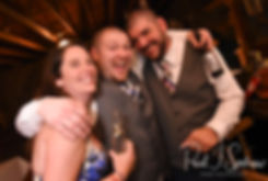 Adam poses for a photo with friends during his September 2018 wedding reception at Stepping Stone Ranch in West Greenwich, Rhode Island.