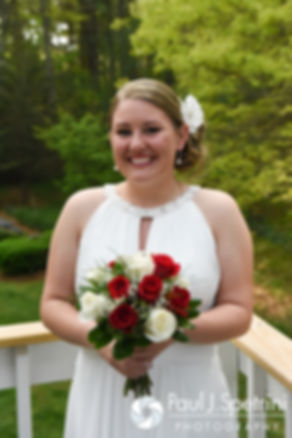 Latasha smiles for a photo prior to her May 2016 wedding at Country Gardens in Rehoboth, Massachusetts.