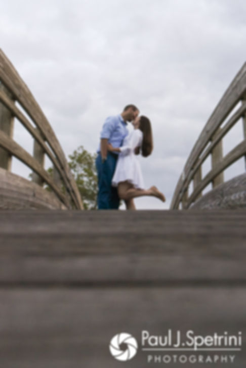 Jessica and Keiran kiss on a bridge at Ryan Park in North Kingstown, Rhode Island during their August 2017 engagement session.
