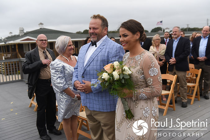 Arielle walks down the aisle with her father during her September 2017 wedding ceremony at North Beach Club House in Narragansett, Rhode Island.