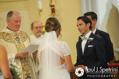 Bruce reads his vows during his August 2017 wedding ceremony at St. Joseph Church in New London, Connecticut.