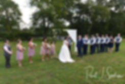 Adam and Ashley listen to their officiant during their September2018 wedding ceremony at Stepping Stone Ranch in West Greenwich, Rhode Island.