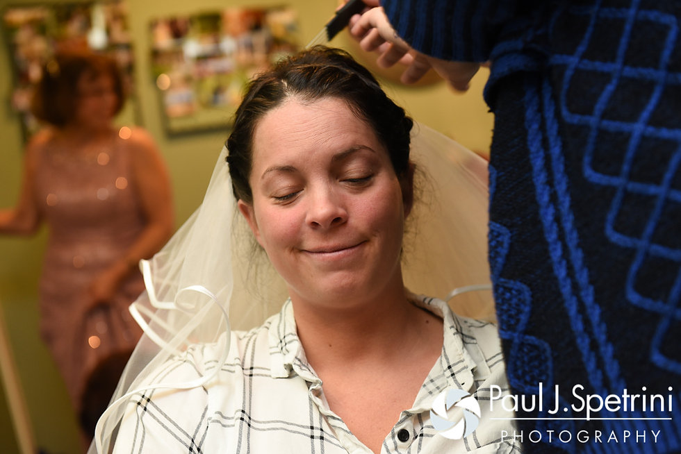 Kelly has her veil applied prior to her November 2016 wedding ceremony at the Bay Pointe Club in Buzzards Bay, Massachusetts.