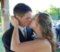 Kelly and Jeremy share a kiss during their August 2010 wedding.