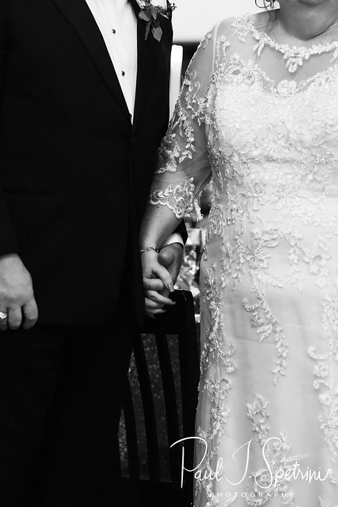Patti and Bob hold hands during their August 2018 wedding reception at the Olde Colonial Cafe in Norwood, Massachusetts.