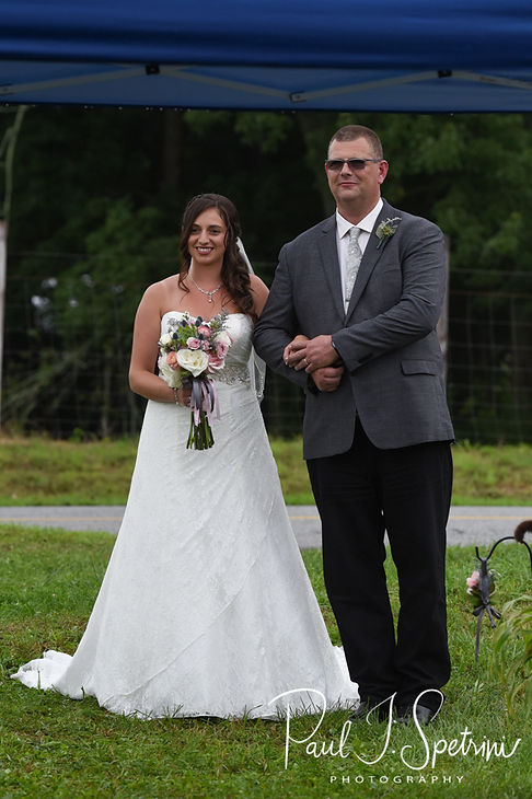 Karolyn walks down the aisle with her father during her August 2018 wedding ceremony at a private residence in Sterling, Connecticut.