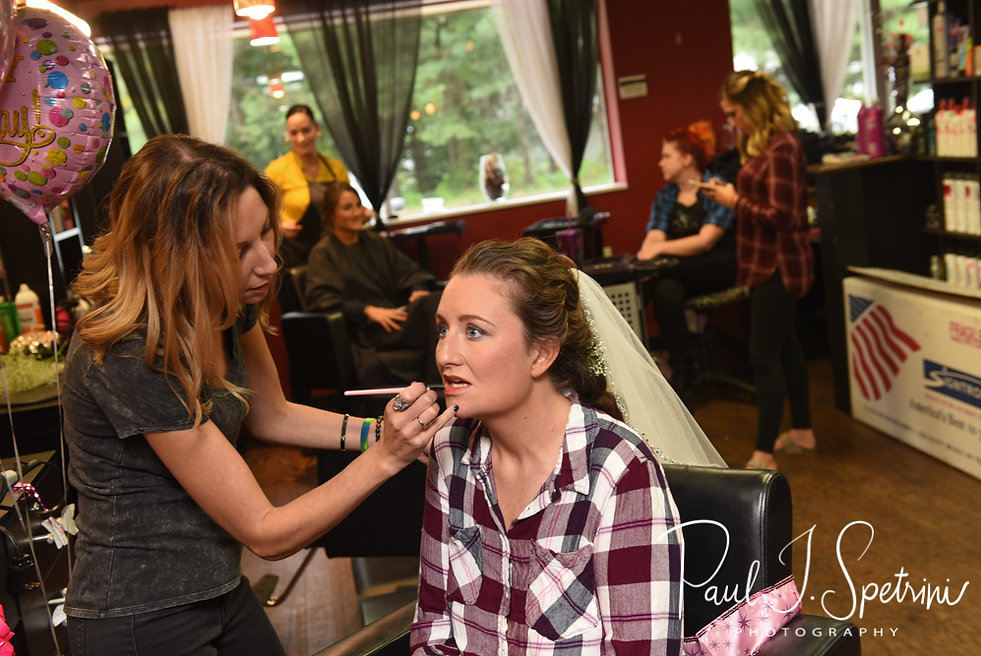 Allie has her lipstick applied during her hair and makeup appointment at Per Case Salon in Smithfield, Rhode Island prior to her October 2018 wedding ceremony at South Ferry Church in Narragansett, Rhode Island.