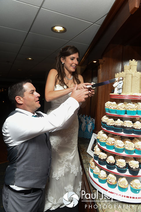 Marissa and Paul cut the cake during their September 2016 wedding reception at the Aqua Blue Hotel in Narragansett, Rhode Island.